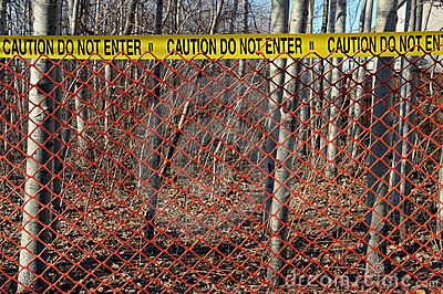 Crime scene with red fence in the woods