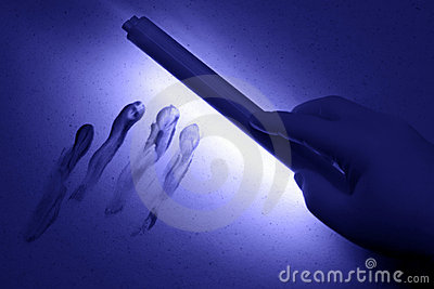 Crime Scene under UV Black Light Wand in Tech Hand