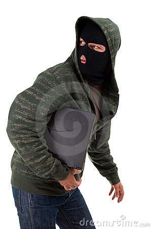 Criminal in balaclava with the laptop