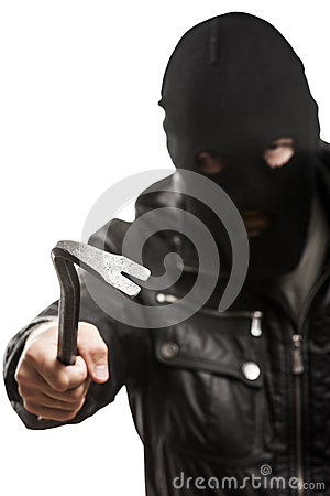 Criminal burglar man in mask holding crowbar