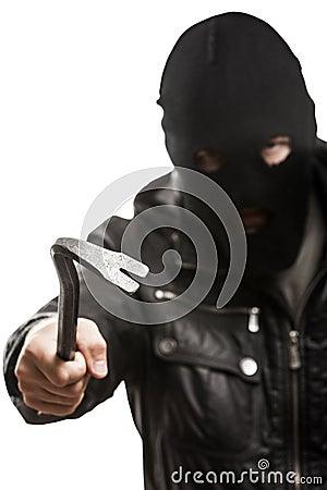 Criminal burglar man in mask holding crowbar