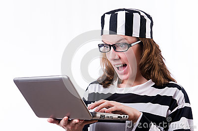 Criminal hacker with laptop
