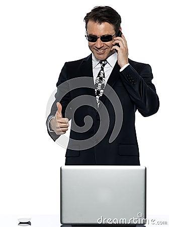 Criminal man computer hacker satisfied happy