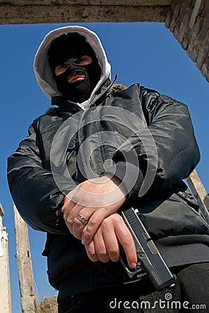 Free Criminal With A Gun Royalty Free Stock Photos - 13564648
