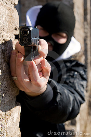 Free Criminal With A Gun Royalty Free Stock Photography - 13597327