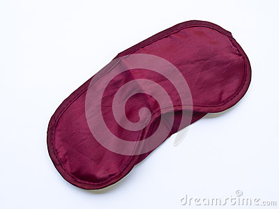 Crimson sleeping mask isolated on white background