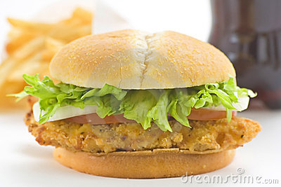 Crisp chicken burger tomato onion cheese lettuce