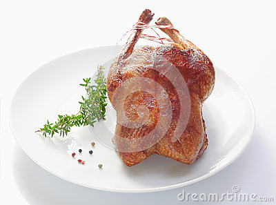 Crisp golden roast duck and rosemary