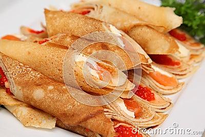 Crispy pancakes with red caviar and salmon