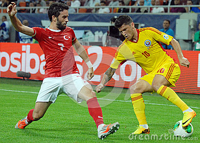 Cristian Tanase and Gokhan Gonul players in Romania-Turkey World Cup Qualifier Game Editorial Stock Photo