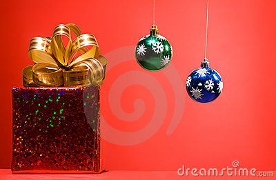 Cristmas gift red box with golden bow