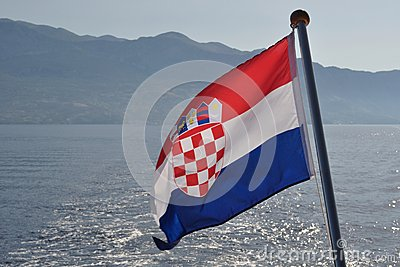 Croatian national flag flying at windy day