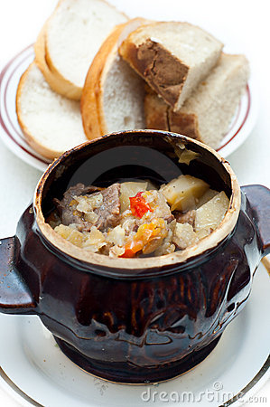 Crock pot full of beef and potato soup