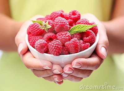 Crockery with raspberries.