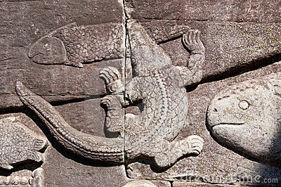 Crocodile catching fish carving, Cambodia