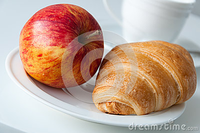 Croissant and apple breakfast