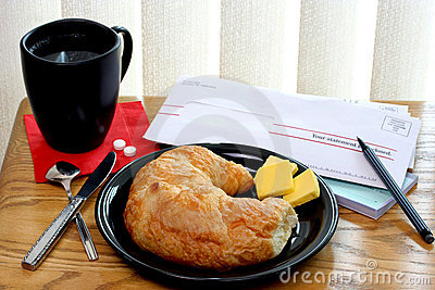 Croissant, Coffee and Bills