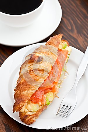 Croissant filled with smoked salmon and coffee