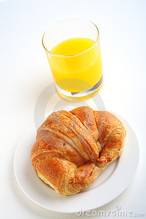Croissant and juice vertical