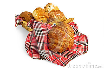 Croissant and muffins in a basket with a napkin
