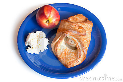 Croissant, peach and cream cheese on a plate
