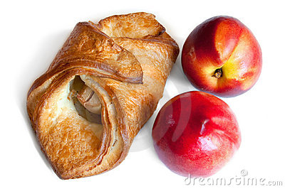 Croissant and red peaches isolation on white