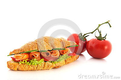 Croissant with salmon and vegetables