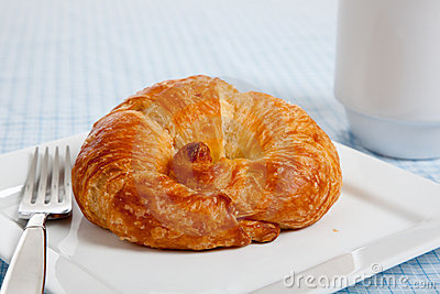 A croissant on a white plate