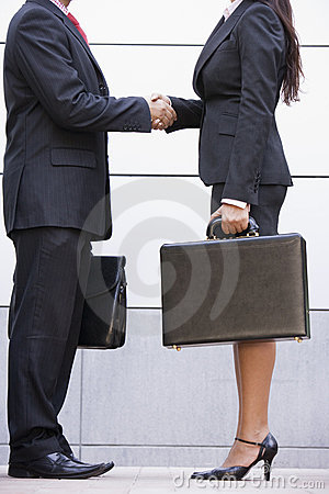 Cropped image of business meeting outside office