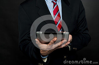 Cropped image of businessman browsing tablet pc