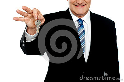 Cropped image of businessman holding keys
