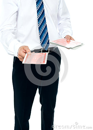 Cropped image of a man holding playing cards