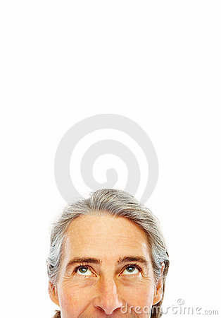 Cropped image an man  s face looking upwards