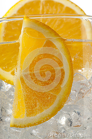 Cropped image of orange slices with ice cubes.