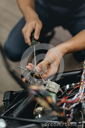 Free Cropped View Of Mechanic Repairing Motorcycle Royalty Free Stock Photo - 120687135