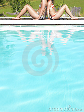 Cropped View of Two Women by Pool