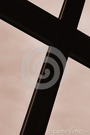 Cross against cloudy sky