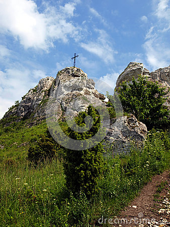 The cross on the background of clear sky at the top Biaklo (or M