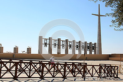 Cross, bells and birds near Padre Pio Church, Italy Editorial Stock Photo