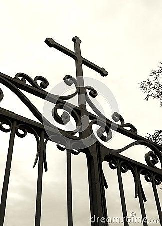 Cross on church gate, silhouette