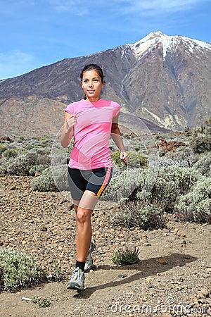Cross-country trail runner - woman running
