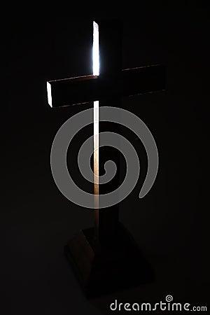 Cross in dark.