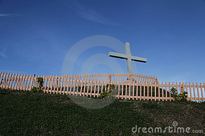 Cross and fence on hill