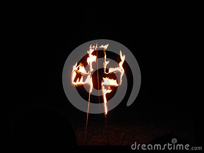 Cross in Fire by Night