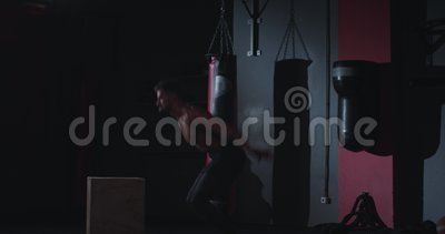 In a cross fitness class strong athletic guy doing the box jumping exercises on the wooden crates , have a intense. Workout. 4k stock footage