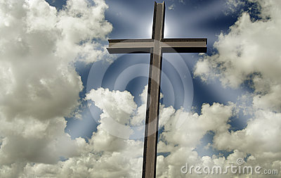 Cross in front of shining sun and clouds