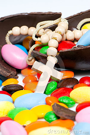 Cross gainst easter chocolate egg and sweets