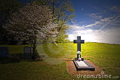 Cross headstone on grave