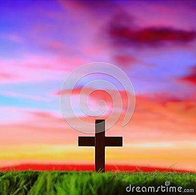 Cross silhouette in sunset