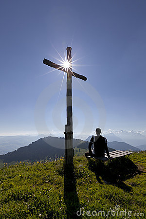 Cross with sun and man
